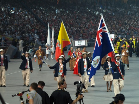 Cayman Team at the Olympic Opening Ceremony. L-R in the photo are: Attaché - Matthew Bishop, Swimming Coach - Dominic Ross, Chef de Mission - Lori Powell, Swimmer - Brett Fraser (200 back), Athletics Coach - Kenrick Williams, Track athlete - Cydonie Mothersill (200 m) Track athlete & Flag Bearer - Ronald Forbes (110 hurdles)