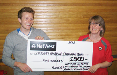r-l Coach Bobby Oag and Orkney ASC President Helen Rothnie with cheque for £500 from the NatWest Sports Development Programme